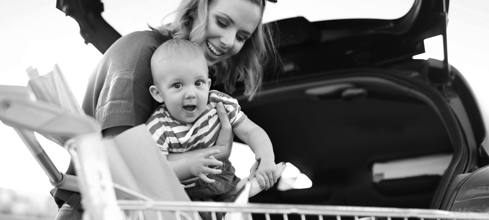 Mother and son loading groceries into car